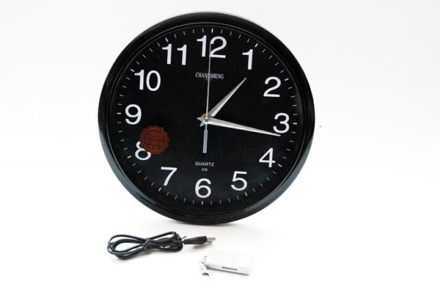 Wall clock with camera