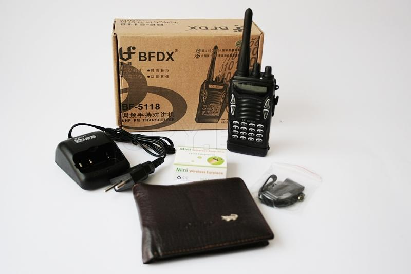 Set - headset and transmitter hidden in a wallet